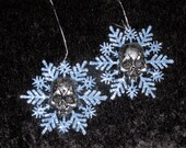 silvery blue snowflakes with silver skulls ornaments