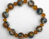 Elastic Stretch Bracelet with Blue, Caramel and Beige Handmade Polymer Clay Swirl Colored Beads and Amber Bicone Crystals