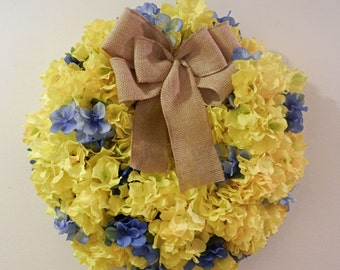 Spring/Summer wreath with yellow and blue hydrangeas with burlap bow