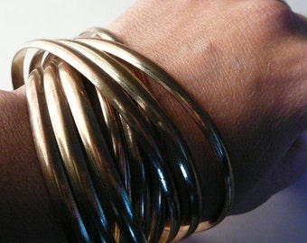 Vintage Multiple metal bangle bracelet 9 thin bracelets Wide stacking