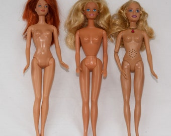 Three Barbie Dolls Two with Blonde Hair, One Red Hair, All Blue eyes