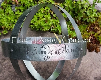 Etched metal armillary Earth Laughs in Flowers
