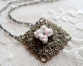 Square filigree necklace with four white porcelain roses, Sara