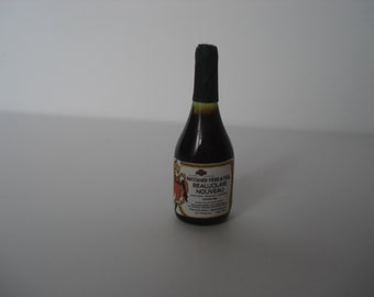 Miniature red wine glass bottle