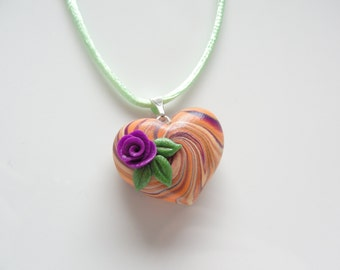 Heart necklace in orange, purple and pale green colours handmade from polymer clay