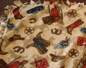 Boots and Saddle tied fleece blanket with lite color background