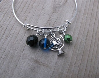 Globe Bangle Bracelet- Adjustable Bangle Bracelet with globe charm and glass beads in black, blue, and green