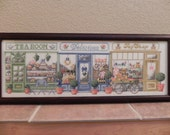 Pastel Storefronts Scene Framed Cross Stitched Picture