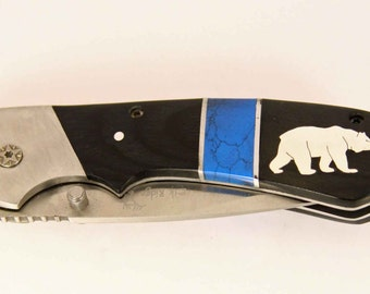 Elk Ridge Pocket knife with custom Silver Bear inlay
