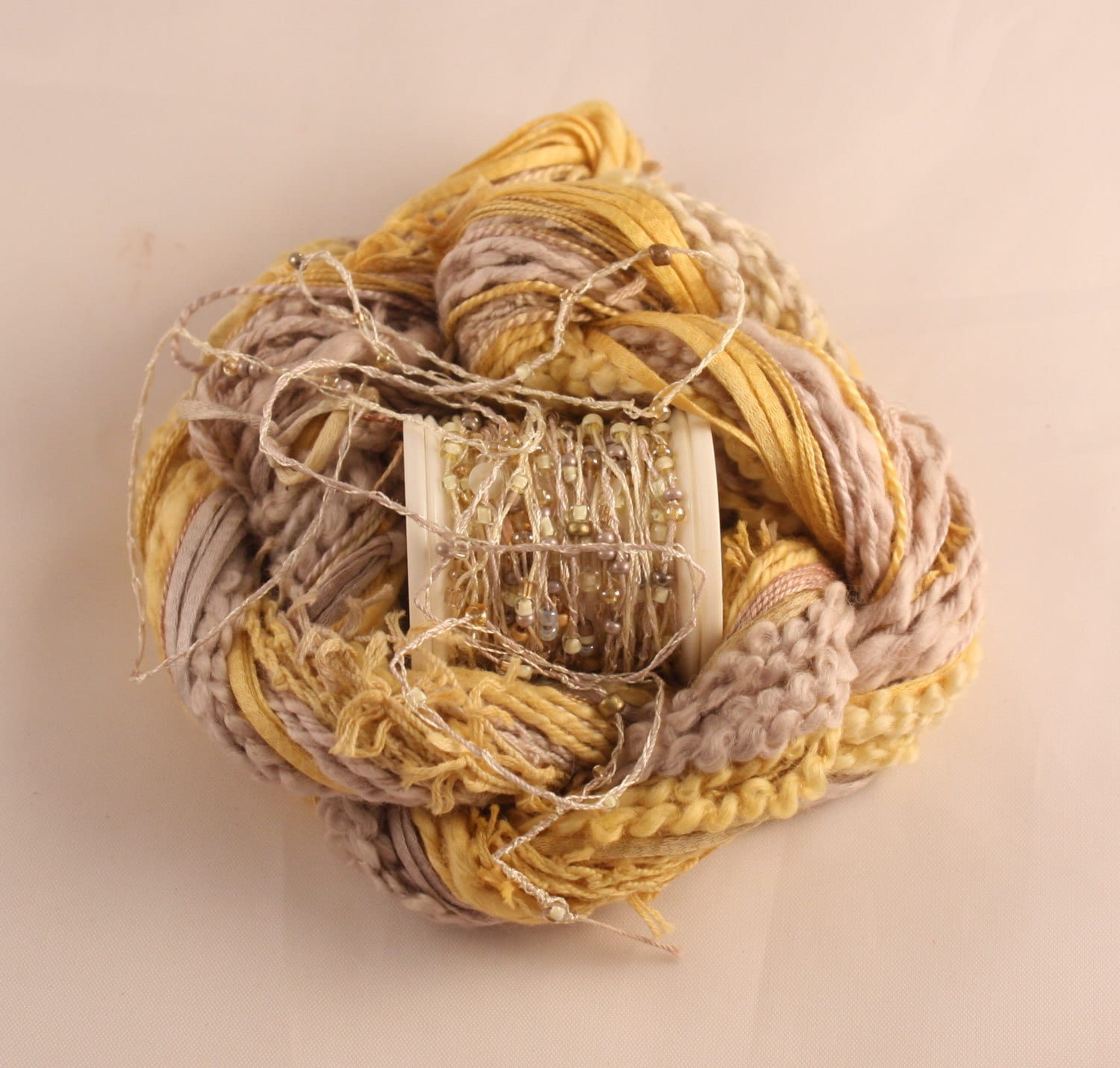 Beige golden yellow beaded embroidery thread with seed beads