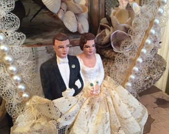 This Vintage Wedding CakeTopper  Has Stood The Test Of Time