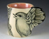 Bird cup in black and white stoneware with wing handle and two faces