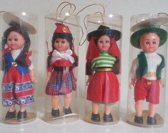 4 vintage folk dolls | international ornament dolls | vintage doll ornaments | vintage dolls in plastic tubes | small international dolls