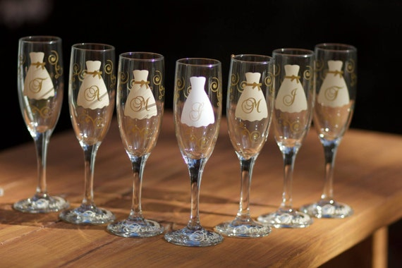 12 Bridesmaids champagne flutes, Personalized glasses, Champagne and ivory wedding theme, monogram.  Ivory and gold. Bridesmaid gift idea