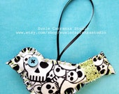 Hand Stitched Skull Fabric Bird Ornament. Reversible: Denim Fabric on Back. Blue Button, Green Lace and Stitching.
