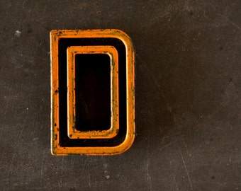 "Vintage Industrial Letter ""D"" Black with Light Orange and Blue Paint, 2"" tall (c.1940s) - Monogram Display, Shadow Box Letter, Art Supply"