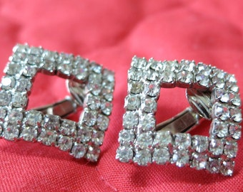 """Vintage clip on rhinestone earrings, square, gently curved sides, open center, 2 rows claw set stones, 1"""" in sq. UNK13.5-14.7-19-2."""