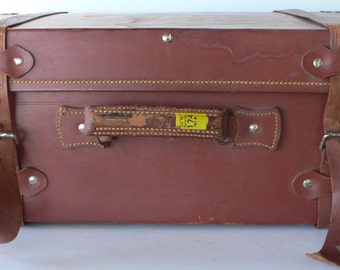 vintage leather trimmed trunk, battered and worn, storage, from Diz Has Neat Stuff