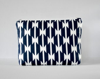 Padded woman's navy blue Native American shapes travel make up pouch cosmetics bag in large.