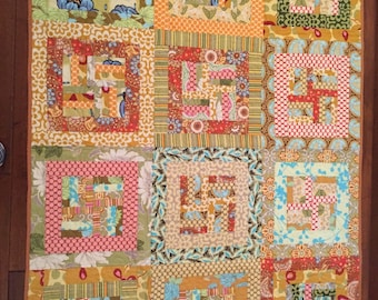 Handmade quilt using Amy Butler fabric