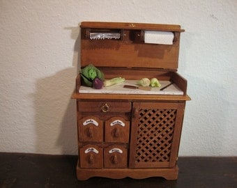 dollhouse miniatures larder with marble worktop.
