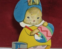 Swee 1920's Dennison's die cut easter cut out of boy bunny wearing painter's beret painting giant Easter egg next to large can of paint