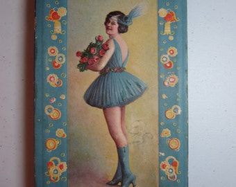 Pretty 1920's art deco deeply embossed chocolates box with flapper dressed risque and holding a bouquet of roses