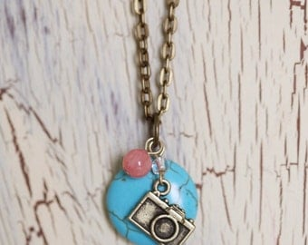 Turquoise Round Stone Necklace with Coral Bead and Antique Brass Camera Charm