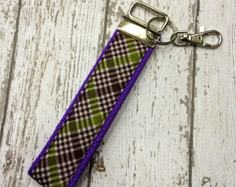 Purple and green plaid print key fob wristlet on purple cotton webbing with swivel lobster clasp