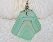 Sea glass style recycled glass pendant in swirly spearmint green
