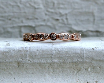 Custom 14K Rose Gold Diamond Wedding Band.