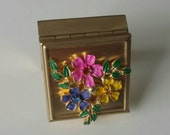 Vintage gold tone pill box with flower cluster