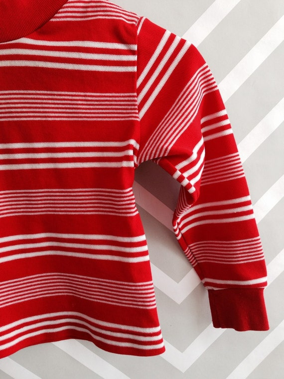 Lulus Exclusive! Basics don't have to be basic! And the Lulus Basics Romeo Red and White Striped Long Sleeve Bodysuit proves it! Soft ribbed knit fabric, in a red and white stripe print, shapes a V-neckline and a fitted, darted bodice that continues into thong bottoms with a double snap closure. Long fitted sleeves frame the fun look.4/5(2).