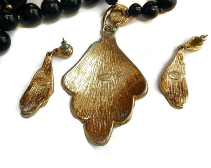 Black Trifari necklace and earrings modernist with gold accents, lucite pendant and earrings demi parure set with black lucite beads.