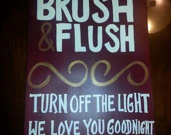 Wash Brush Flush sign