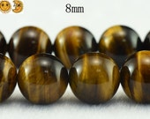 15 inch strand of yellow tiger eye smooth round beads 8 mm