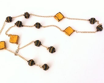 1960s Artisan paper mache necklace with gold tone chain , yellow and black elements