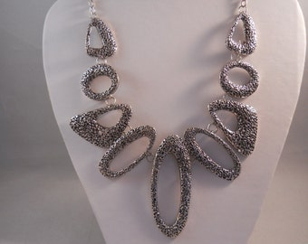 Bib Necklace with Silver Tone Pendants on a Silver Tone Chain