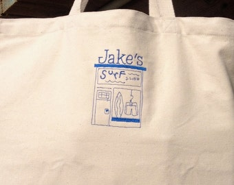 Personalized canvas tote with a surf shop design