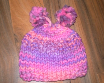 soft and snuggly hand knitted baby hat with 2 pom poms pink orange mix 0-3 month