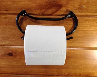 Canoe toilet paper holder
