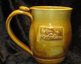 I Aim to Misbehave mug, golden brown, #17, 16oz
