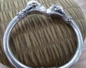 Ram's head clamper bracelet, silver and dark blue enamel