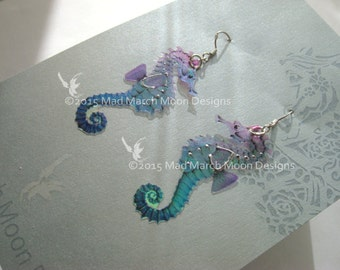 Micro Seahorse earrings, iridescent with sterling silver ear wires, various colours.  Latch back and clip on version available