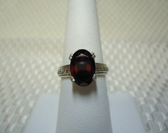 Oval Cut Garnet Ring in Sterling Silver
