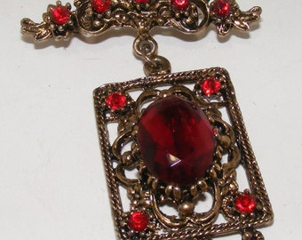 Vintage Decorative Bronze Brooch with Red Stones