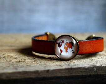 World map bracelet Antique world map jewelry Leather bangle wrap bracelet Brown leather bracelet Glass dome bracelet traveler wanderlust