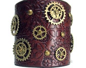 Steampunk leather bracelet , custom cuff with turning gears, brasssprockets adjustable straps in stock and read to ship 100% handmade