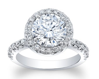 Ladies 18kt white gold diamond engagement ring 0.66 ctw G-VS2 with 2ct natural White Sapphire Round Brilliant center