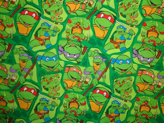 Green Teenage Mutant Ninja Turtle Shell Toss Cotton Fabric By